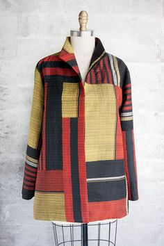 JACKET IN MIXED STRIPES AND LAYERS OF STITCHING