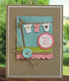 New baby card - straight from the nest cricut cartridge -- I love the little t-shirts on the line! :)