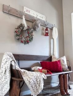 pinecone wreath, a warm throw and red color for a stylish and warming up winter look