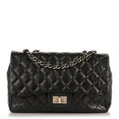 This is an authentic CHANEL Washed Lambskin Quilted Jumbo Hybrid Reissue Flap in Black. This stunning shoulder bag is crafted of luxurious diamond quilted washed lambskin leather.