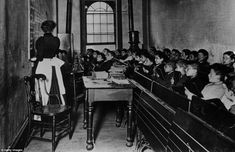Pupils in the Essex Market school in a poor quarter of New York listen intently during a lesson