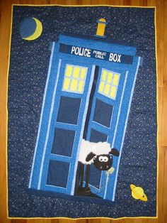"""Thisquilt was madeas a baby shower gift for afriend who is a big fan of the British shows """"Dr. Who"""" and """"Wallace & Gromit"""". For the TARDIS, I used the proportions listed as the..."""