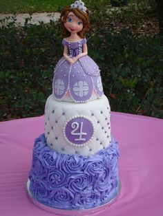 Sofia the First cake for my daughter, Sophia's 4th birthday. Topper sculpted from rice treats and fondant. Bottom tier buttercream rosettes.