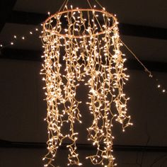 DIY Chandelier...painted hula hoop. Icicle lights...great for outdoors!