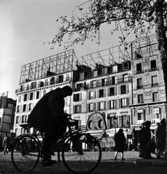 A man riding his bicycle through the heart of Montmartre. Photograph by Ed Clark. Paris, February 1946.