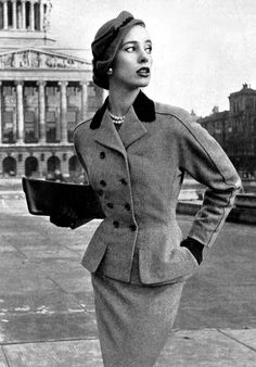 Model in elegant town-suit by Frederick Starke, Vogue UK ♥ February 1952