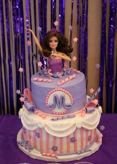 Barbie Princess and the Popstar cake with Popstar Keira coming up out of the top.  This cake baker has made other cakes for birthdays and showers for me and is AMAZING.