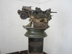 """Band of Brothers"" Artist ~ James N. Muir. Donated by Tom and Cheryl Lincoln. 1943 Jeep Axle Donated by R. Scott Prast, Restoration by MSGT Ronald Greer USAF (Ret)."