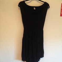 Simple Black Dress Super cute black dress with high low skirt. Boat Neckline, triangle cutout on back, sleeveless. Love this dress, wore it a few times but now it's too small! Hits a little above mid thigh. Dresses High Low