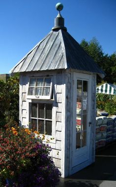 Bob Bowling crafts little buildings like this one out of recycled materials.