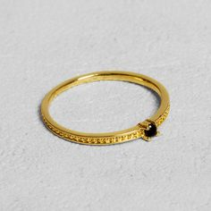 Petit Sesame | Gold-plated black vendetta ring | Designed by Petit sesame | $12.00 | 18k gold plated full brass ring adorned with a black cubic zirconia stone