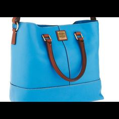 """BRAND NEW Dooney & Bourke Dillen Leather Handbag BRAND NEW.  Color is Aegean Blue.  North/south design. 5"""" double handles. Adjustable shoulder strap. Middle zipper compartment.   12-1/2""""W x 12""""H x 6-1/4""""D.  100% genuine leather. Comes with a dustbag. Dooney & Bourke Bags"""