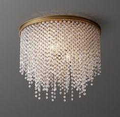 RH Baby & Child's Athena Crystal Flushmount - Antiqued Brass/Clear:Our Athena Crystal Flushmount commands the room with unabashed drama. Its opulent tiered design sparkles with dripping strands of elegant crystal beads.