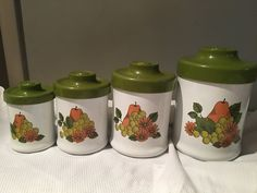 Atapco vintage metal and melamine kitchen canisters. Green white pears