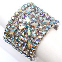 Signed Sherman, signature cuff bracelet with aurora borealis blue crystals. Circa 1960
