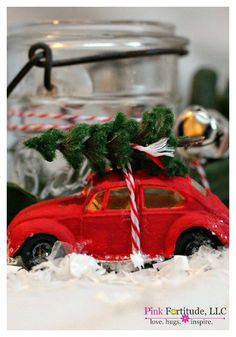 These little red cars with the Christmas trees on top are quot;THE IT quot; item this holiday season. This DIY will take you through an easy process to have your red vintage Beetle Bug with a tree tied to it - regardless of how you want to display it. Christmas Tree Tops, Christmas Room, Christmas Candy, All Things Christmas, Christmas Crafts, Christmas Ornaments, Christmas 2016, Tree Decorations, Christmas Decorations