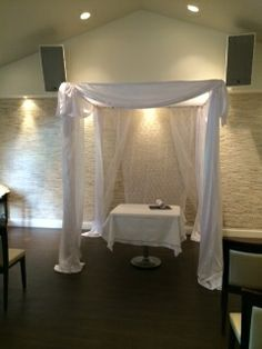 Modern Chuppah with heavy drapes and lace canopy www.chuppah.ca @Sassafraz