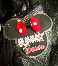 Summit Bound bag tags. These make great little celebration gifts for when a cheer team receives a summit bid. Male athlete version is just a Mickey head over the year and no bow. Can also be customized with the competition info the bid was received at, date, athlete name, team name, gym logo, etc.