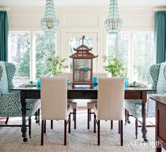 Now here is a dining room that is fearless and obsessed with color and is absolutely magnificent! Layers of turquoise on the window treatments and wingback chairs rock with the chandeliers!