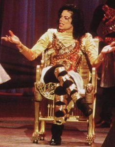 That time he had to perform seated because he twisted his ankle(Poor Baby), yet, as always, got a standing ovation. That's Michael!:)