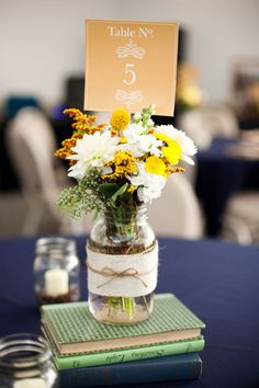 simple Centerpiece (books, jar, wildflowers, and table card, add some jars with candles around)