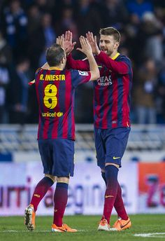 Andres Iniesta and Gerard Pique of FC Barcelona celebrates after defeating Real Sociedad at the end of the Copa del Rey Semi Final second leg match between Real Sociedad and FC Barcelona at Anoeta Stadium on February 12, 2014 in San Sebastian, Spain.