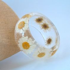 Daisy Resin Bangle.  Pressed Daisies Bracelet.  Real Flowers - Pressed Daisies.  Handmade Resin Jewelry. $44.00, via Etsy.