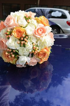Lisa's Peach Bouquet - peach roses, berries, creamy hydrangea and white ranuculus. www.sendingsmiles.com