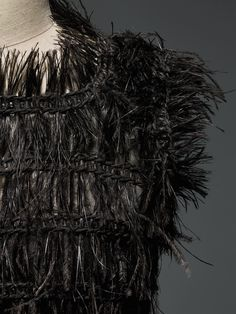 House of Chanel (French, founded 1913). Karl Lagerfeld (French, born Hamburg, 1938). Dress (detail), autumn/winter 2015–16, Haute Couture. Hand–sewn black silk tulle, hand–embroidered by Lemarié with black crystals and black silk passementerie hand–woven with hand–glued and –stitched black ostrich feathers. Photo © Nicholas Alan Cope. #ManusxMachina #CostumeInstitute