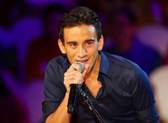 Gianluca Bezzina, is a doctor but also a part-time singer who now represents Malta. His Eurovision entry is penned by Boris Cezek and Dean Muscat. Eurovision Songs, Muscat, Malta, Dean, Singer, Artists, Malt Beer, Artist, Grout
