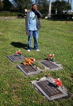 Michael Barnett, 45, is overcome with grief while visiting the graves of his three children who were killed — his oldest boy survived the attack — by his ex-partner's husband, Patrick Dell.