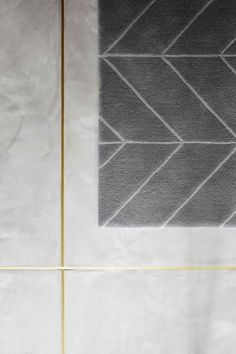Light colored, large tile, gold grout