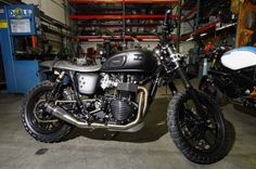 "This Roland Sands creation was the featured ""Bike of the Week"" on Yahoo! Finance Canada. The Triumph Scrambler was treated to a host of RSD modifications, most notable are the one-off Black Ops Del Mar wheels, RSD Stepped Enzo seat and handmade stainless steel RSD Slant low exhaust, which creates an ""aural symphony."""
