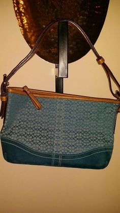 d00bee2273 Authentic Teal color Coach bag with peanut butter trim and silver hardware.  The matching wallet