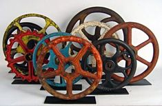 colorful valve wheels mounted like sculptures