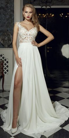 9ae6f9edeb a glamorous top with fancy décolletage and a sheer open back Slit front a  line wedding
