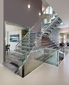 Tricky Structural Stainless Steel Staircase with Treads attached to Glass Wall