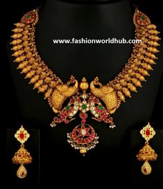 22 carat gold antique finish Peacock necklace studded with kundansbyVummidi Jewellers. 170 grams heavy necklace designs, temple work designs in 1 lakh rupees gifts to girl friends in low cost rings, wedding rings, delicate rings for cheap rates gold coated rings for wedding