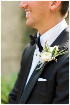 Boutonniere with ranunculus and olive leaves Victory Blooms. Image by Rustic White Photography.