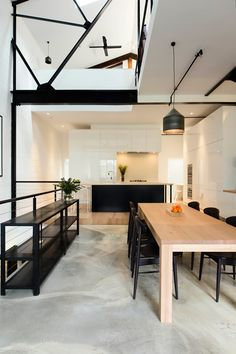 Black painted beams and natural wood give a nice contrast in this minimalist warehouse-turned-home. Design by Warehouse Living, Warehouse Design, Warehouse Loft, Minimalist Dining Room, Minimalist House, Modern Minimalist, Minimalist Decor, Minimalist Design, Modern Dining Table