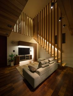 House is a private residence designed by Architect Show Co. in It is located in Hasami, Nagasaki, Japan, and makes extensive use of differently-toned wood to link the different spaces of the home. Photos courtesy of Architect Show Co. Home Stairs Design, Railing Design, Interior Stairs, Home Interior Design, Wall Design Outside House, Luxury Interior, Stair Design, Small House Design, Room Interior