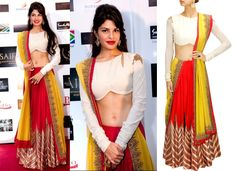 GET THIS LOOK: Jacqueline Fernandez looks radiant in an outfit by Anand Kabra. #jacquelinefernandez #celebritystyle #anandkabra #clothing #lehenga #red #white #perniaspopupshop #shopnow
