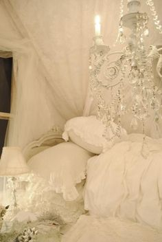 Shabby chic bedroom with chandelier