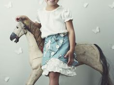 I am IN LOVE with this skirt.  When The Girl is a little older, this would be cute!