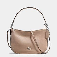 chelsea crossbody by COACH. Modern, minimalist Chelsea gets a textural update in our plump pebble leather. This swingy and very versatile design ...