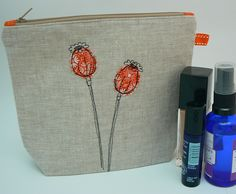 Pretty Poppy Seedhead, handmade applique and free-machine embroidery linen cosmetics bag or wash-bag, with waterproof nylon lining by Moogsmum on Etsy