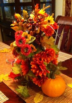Thanksgiving decorations. Made with a Vase flower from the dollar store and flowers from Michael's.