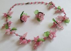 """This has pink glass bird beads with green glass leaves and pink glass beads. This necklace measures 18 1/2"""" long. Earrings are 1 1/4"""" Marked made in italy on earrings."""