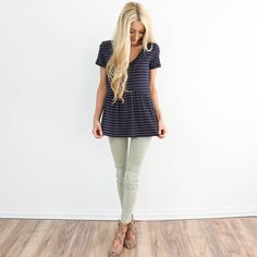 Colors: Navy blue with light yellow and pink stripes I'm 5'3 wearing size small 95% Rayon , 5% Spandex wash on cold / hang dry