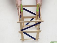 How to Build a Popsicle Stick Tower. Popsicle stick towers are a common engineering project to be assigned in school.Your assignment may have various criteria for height, weight, and number of popsicles, but this guide will give you a. Wood Glue, Popsicle Sticks, Diy Wood Projects, Popsicles, Tower, Building, Pictures, Room Ideas, Challenge